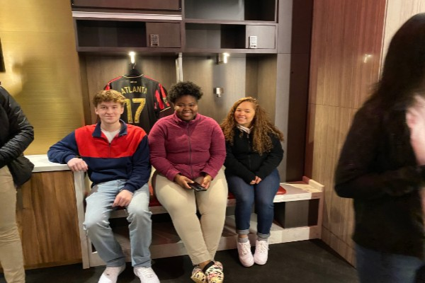 GIFTED TEACHER LAURA COSTELLO HOSTS A  FIELD TRIP TO THE MERCEDES-BENZ STADIUM --- Juniors Grayson Catlett, Destiny Smith sit in the players' locker room with other gifted students.