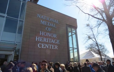 NATIONAL MEDAL OF HONOR HERITAGE CENTER OPENED TO THE PUBLIC -- Community members and recipient families gather at the entrance of the newly-opened museum.