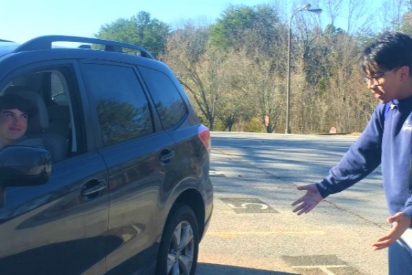 CENTRAL HIGHS PARKING LOT: A CHALLENGE OR LEARNING EXPERIENCE? -- Students, administrators, and parents alike know how hectic and stressful it can be to enter and exit the schools parking lot.