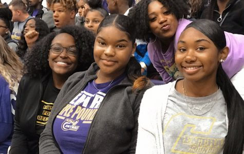 EDITORIAL: ARE SCHOOL HALF DAYS NECESSARY? -- Students are gathered at the pep rally. From left to right are Seniors Jahnia Russell, Khalia Shepard, and Janai Blakemore. At the top right is Senior Genesis Harris.