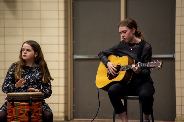 CENTRAL HIGH HOSTS STUDENT TALENT SHOW -- Anna Markstrom plays the guitar and Sarah Katheron Latham plays the African drums.