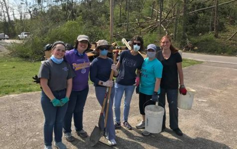 CENTRAL TEACHERS VOLUNTEER TO HELP THOSE AFFECTED BY EASTER TORNADOES -- Central teachers and Digest Staff Writer Sarah Katheron Latham volunteer through the YMCA to clean up storm damage.