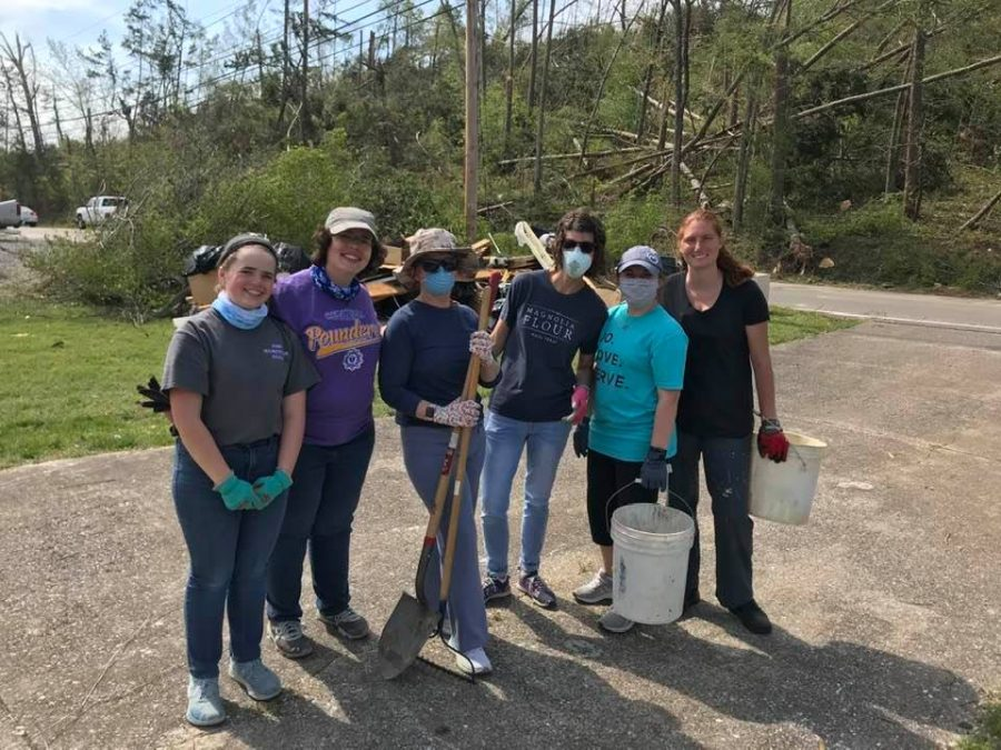 CENTRAL+TEACHERS+VOLUNTEER+TO+HELP+THOSE+AFFECTED+BY+EASTER+TORNADOES+--+Central+teachers+and+Digest+Staff+Writer+Sarah+Katheron+Latham+volunteer+through+the+YMCA+to+clean+up+storm+damage.