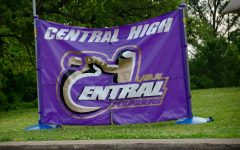 Central's football banner stands at the front of the school as students drop off and pick up their things.
