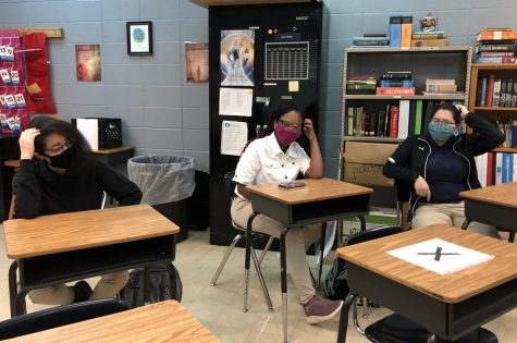 UNCERTAINTY IS CERTAIN, SO KEEP LOOKING FORWARD -- Students in Mr. Fletcher's fourth period class scratch their heads in confusion.