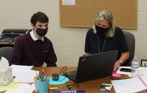 ANGIE HENTZ JOINS CENTRAL FAMILY AS ADVANCED STUDIES TEACHER -- Angie Hentz helping  gifted student Cruz Johnson.