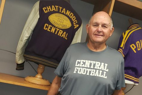 CENTRAL COMMEMORATES COACH JOHN CRAWFORD -- John Crawford is standing beside a Letterman football jacket from his graduation year.