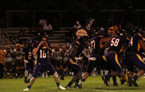CENTRAL LOSES IN WEEK TWO AGAINST TYNER ACADEMY --  Freshman Evan Schwarzl in the pocket protected by junior Mike Watson.