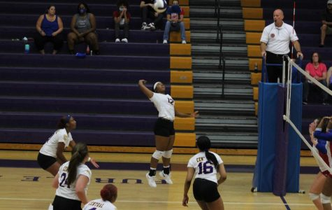 CENTRAL VOLLEYBALL VICTORIOUS OVER DISTRICT OPPONENT THE HOWARD SCHOOL -- Senior Kamren Hammonds spiking in the match against Red Bank.