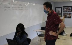 SPANISH TEACHER MARIO ALBA JOINS THE CENTRAL STAFF -- Mario Alba assisting one of his students in class.