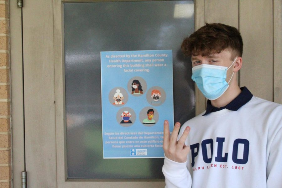 THE GRAY AREA: WHAT DOES EVERYONE THINK ABOUT PHASE THREE? -- Columnist Grayson Catlett poses with one of the many safety posters around Central.