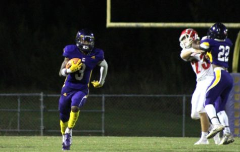THE CENTRAL FOOTBALL TEAM'S HARD WORK PAYS OFF GETTING A WIN FOR THE POUNDERS -- Wide Receiver Tyi Mosely runs the ball down the field for a touchdown, which was later called back.