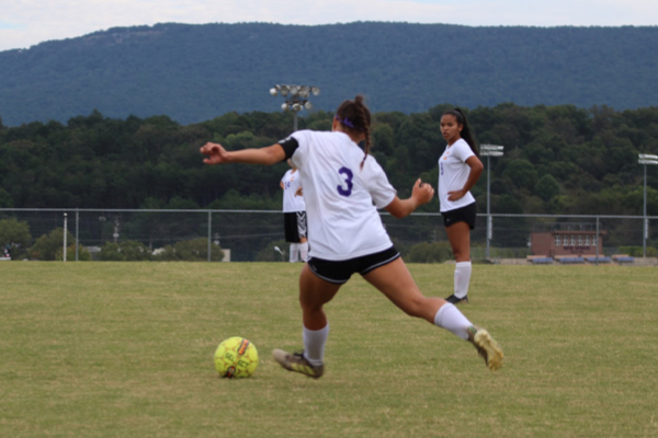 THE GIRLS' SOCCER TEAM TAKES A TOUGH LOSS SEQUATCHIE -- Junior Karleigh Schwarzl kicking the ball to her teammates during the game against Sequatchie.