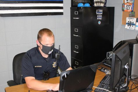 A REINTRODUCTION TO MARCUS DOTSON -- SRO Marcus Dotson working in his office in the main office.