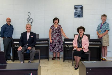 Phil Iannarone, Vance Fry, Katheron Latham, Charlynne Fry, and Buffy Hoge (Left to Right) sit in the piano lab which they helped support.
