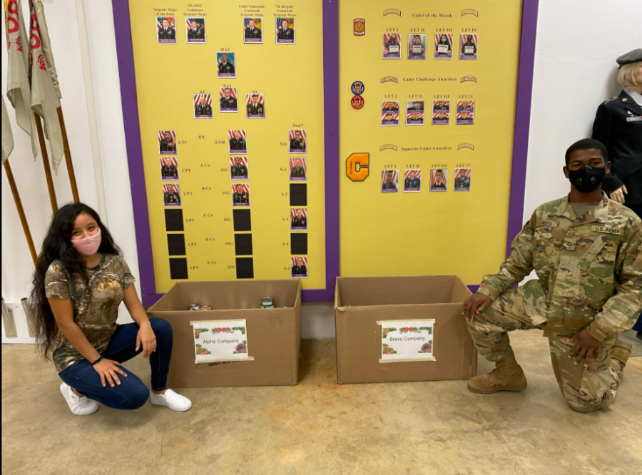 CENTRAL JROTC CONTINUES ANNUAL FOOD DRIVE -- Seniors Dallana Nolazco and Deondree Roberts attending the JROTC Food Drive drop-off in the Armory.