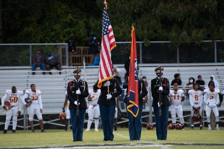 PHOTO GALLERY: HOMECOMING 2020 -- The Central JROTC presents colors as the band plays the Star Spangled Banner.