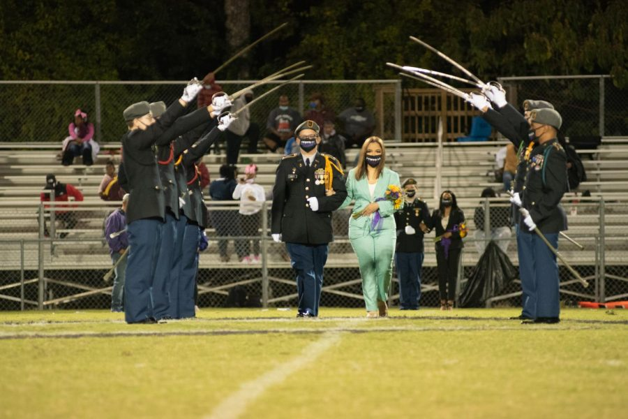 PHOTO GALLERY: HOMECOMING 2020 --Destiny Smith is presented as a member of the 2020 Homecoming Court, escorted by Riley Martin.