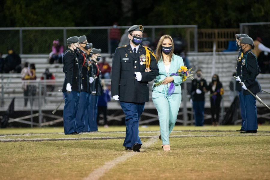 PHOTO GALLERY: HOMECOMING 2020 --Destiny Smith is presented as a member of the 2020 Homecoming Court, escorted by Riley Martin