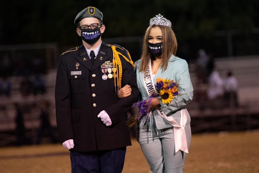 PHOTO GALLERY: HOMECOMING 2020 --Destiny Smith is presented as the 2020 Homecoming Queen, escorted by Riley Martin.