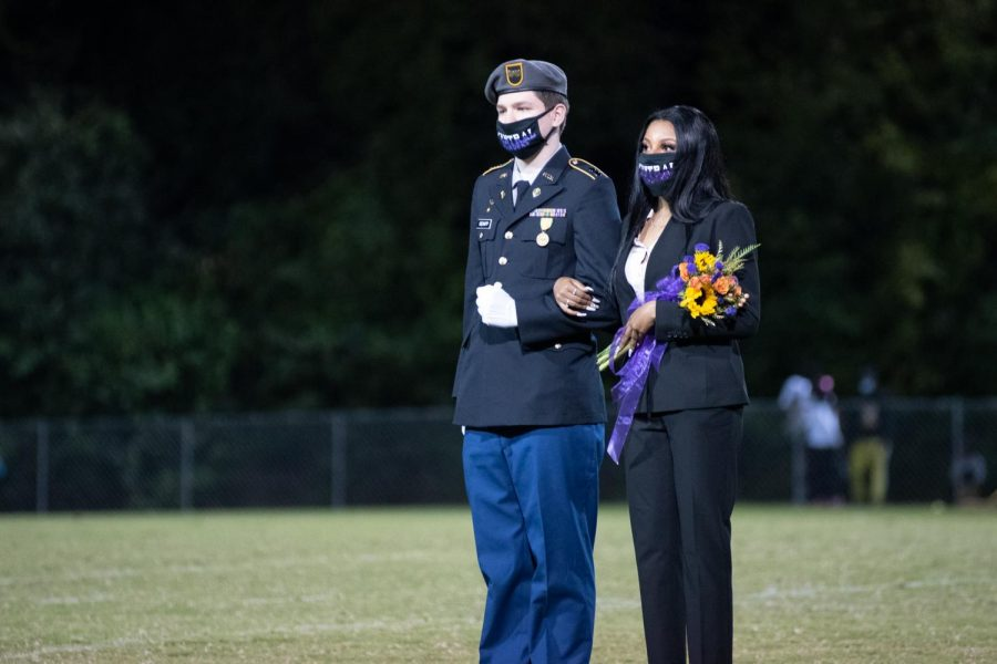 PHOTO GALLERY: HOMECOMING 2020 --Madison Taylor is presented as a member of the 2020 Homecoming Court, escorted by Kaleb Gienapp