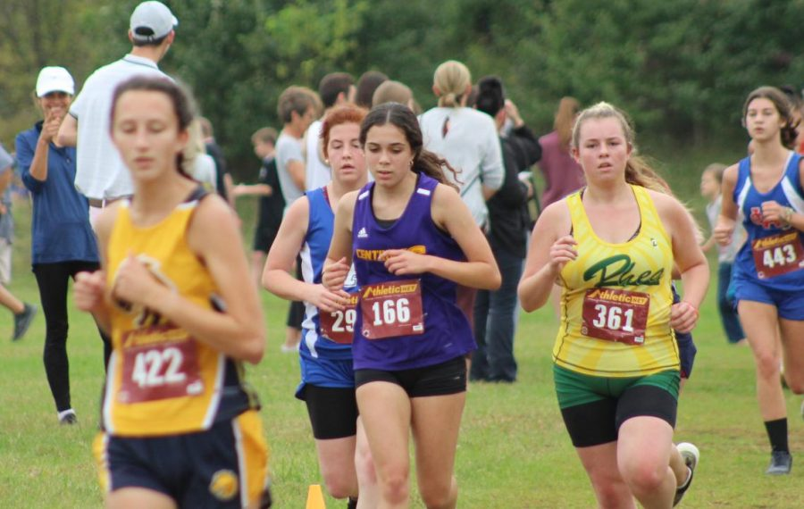 CENTRAL FINISHES STRONG IN CROSS COUNTRY -- Junior Kendra Jones pacing herself to finish her last race strong.