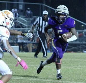 CENTRAL FOOTBALL TAKES A LOSS AFTER A HARD BATTLE AGAINST EAST RIDGE -- Junior, Michael Watson runs the ball downfield.