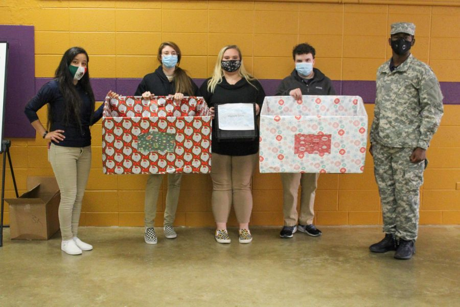 CENTRAL FOCUSES ON OUTREACH DURING A DIFFICULT YEAR-- Dallana Nolazco, Morgan Crites, Makayla Paris, Colby Adams, and Deondree Roberts stand in the armory with collection boxes for the toy and hygiene drives.