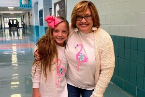 ALUMNA SUZY HALL RETURNS TO TEACH IN HAMILTON COUNTY -- Alumna Suzy Hall embraces a Hunter Middle student.