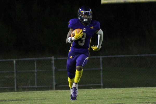 PHOTO GALLERY: CENTRAL FOOTBALL, CHEER, AND STUDENT SECTION FOR 2020-21 SEASON -- Junior Tyi Mosley runs the ball down the field.