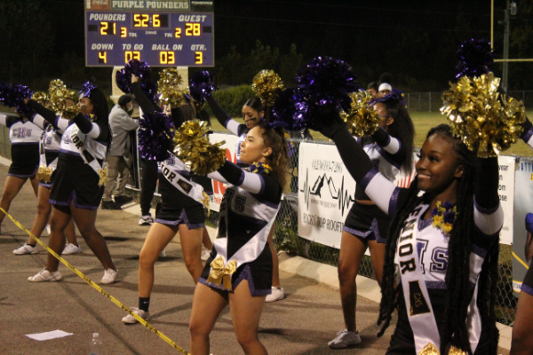 PHOTO GALLERY: CENTRAL FOOTBALL, CHEER, AND STUDENT SECTION FOR 2020-21 SEASON -- The Central cheerleaders cheer on the Pounders during the senior night game against East Ridge.