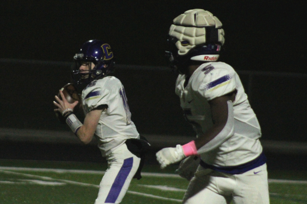 CENTRAL FOOTBALL BEGINS SPRING PRACTICE --Rising Sophomore quarterback Evan Schwarzl looks to throw to rising Senior running back, Michael Watson.