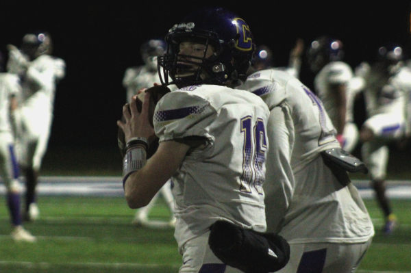 PHOTO GALLERY: CENTRAL FOOTBALL, CHEER, AND STUDENT SECTION FOR 2020-21 SEASON -- Freshman Evan Schwarzl warming up his arm up during halftime.