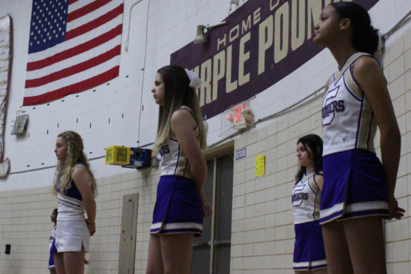 JUNIOR VARSITY CHEER RETURNS FOR 2020-21 BASKETBALL SEASON -- Last year's junior varsity cheerleaders looking towards the basketball court as the junior varsity  basketball team plays.