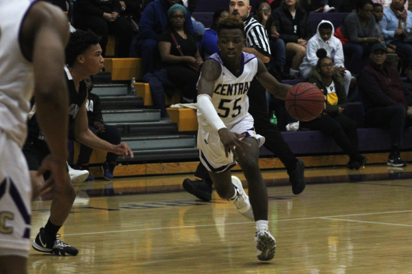 2020-21 BOYS' BASKETBALL SEASON SET TO START -- Senior Kenneth Steward dribbles down the court looking for a pass during a game last season.