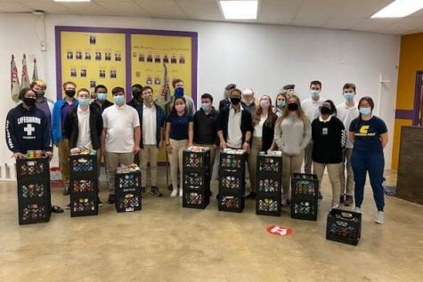 JROTC STUDENTS FACE POSTPONED ASVAB -- Central JROTC Members with the canned goods collected from the JROTC Annual Food Drive
