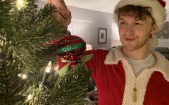 THE HOLI-GRAY SPECIAL-- Columnist Grayson Catlett decorates his family's Christmas tree.