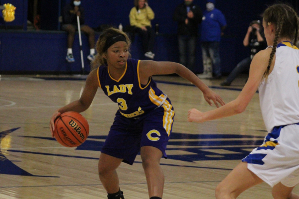 2020 HOLDS ROUGH START FOR GIRLS' BASKETBALL -- Junior Jakiyah Robinson dribbles the ball, looking to charge towards the net.