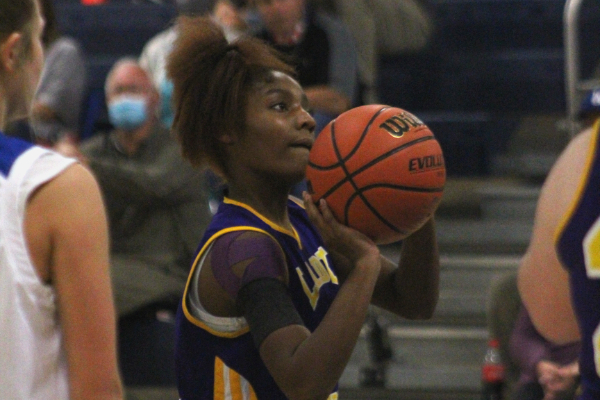 THE LADY POUNDERS LOOK TO MAKE PROGRESS -- Junior Alexis Kennedy shoots a free throw against Boyd Buchanan.
