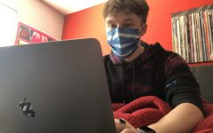 TOPPING 2020 OFF WITH THE CORONAVIRUS -- Senior Columnist Grayson Catlett sits in his bed with a face covering on.