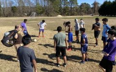 POUNDERS PREPARE FOR 2021 SOCCER SEASON -- Coach Tim Browder and Central soccer players gather before they start practicing to discuss their goals.