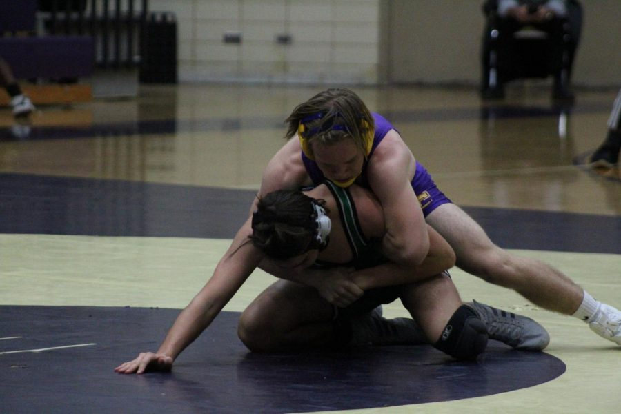 A+WRESTLING+UPDATE+--+Senior+Roby+Thomas+attempts+to+pin+his+opponent+to+the+ground.