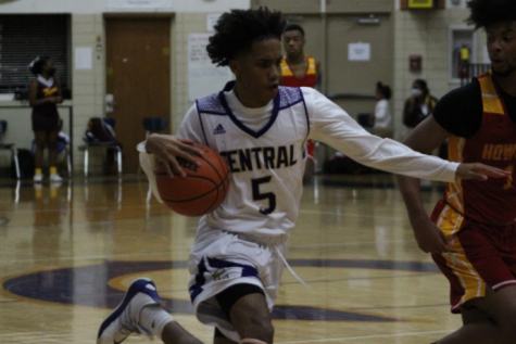 CENTRAL BASKETBALL ADVANCES TO 6AA QUARTERFINALS -- Senior Jaylin Teague drives in a regular season game vs. Howard