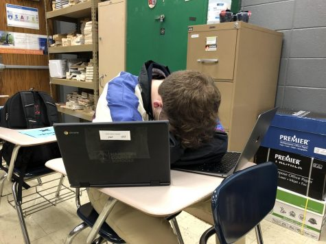 CURING A LACK OF MOTIVATION -- Senior Grayson Catlett falls asleep at his desk, tired of his schoolwork.