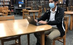TOO MUCH SITTING -- Junior Justin Ramirez completes work in Central's Library.
