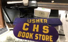 CENTRAL'S LONG HISTORY OF STUDENT INVOLVEMENT -- CHS bookstore and usher armbands sit in a display case honoring Central's past.