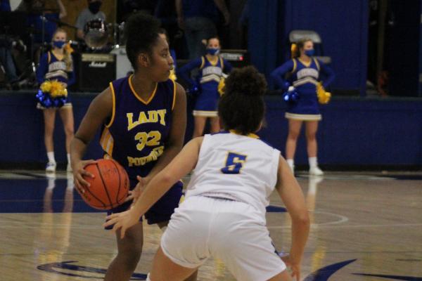 PHOTO GALLERY: CENTRAL GIRLS' BASKETBALL 2020-21 -- Freshman Akeria Range searches for an open teammate against Boyd Buchanan.