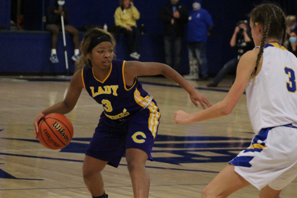 PHOTO GALLERY: CENTRAL GIRLS' BASKETBALL 2020-21 -- Sophomore Jakiyah Robinson dribbles down the court in hopes for an open pass.