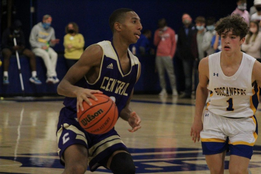 SHOULD SPORTS CARRY ON? -- Senior Donovin Taylor dribbles the ball in a game against Boyd Buchanan.