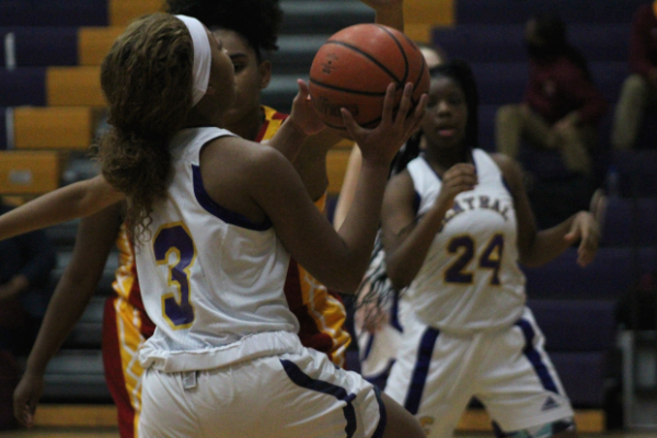 PHOTO GALLERY: CENTRAL GIRLS' BASKETBALL 2020-21 -- Sophomore Jakiyah Robinson goes up for a layup.